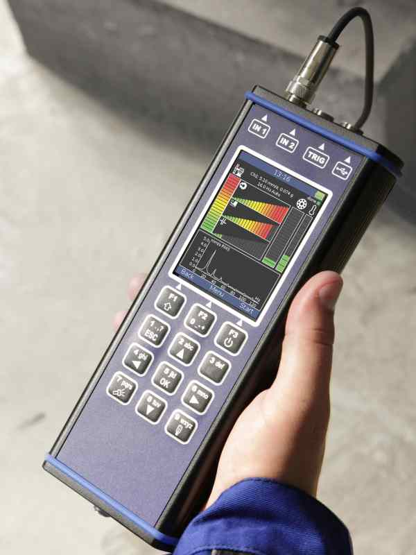 Vibration Meter Pro held in one hand